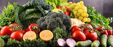 Composition with variety of raw organic vegetables and fruits Stock Photos