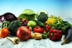Composition with variety of raw organic vegetables and fruits. Balanced diet. Composition with variety of raw organic vegetables and fruits. Balanced diet Stock Image