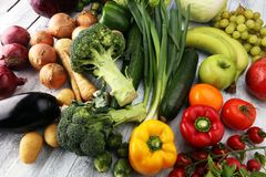 Composition with variety of raw organic vegetables and fruits. Balanced diet. Composition with variety of raw organic vegetables and fruits. Balanced diet Royalty Free Stock Images