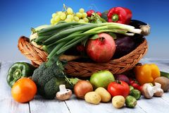 Composition with variety of raw organic vegetables and fruits. Balanced diet. Composition with variety of raw organic vegetables and fruits. Balanced diet Stock Photos