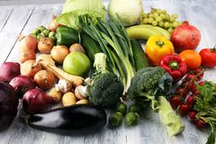 Composition with variety of raw organic vegetables and fruits. Balanced diet. Composition with variety of raw organic vegetables and fruits. Balanced diet Royalty Free Stock Photography