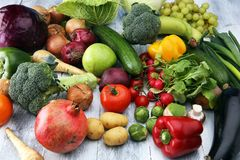 Composition with variety of raw organic vegetables and fruits. Balanced diet. Composition with variety of raw organic vegetables and fruits. Balanced diet Stock Photo