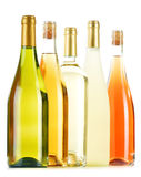 Composition with variety of wine bottles on white Stock Photos