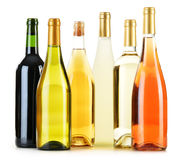 Composition with variety of wine bottles on white Stock Images