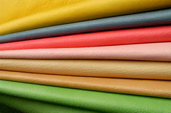 Composition with various colorful skins, leather. Composition with various colorful skins folded stock photography