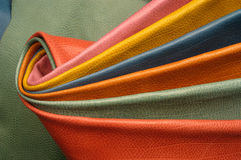 Composition with various colorful skins, leather. Composition with various colorful skins rolled royalty free stock image