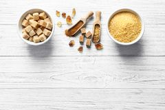 Composition with various kinds of sugar. On wooden background royalty free stock photo