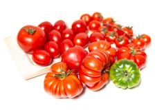 Closeup of various types of tomatoes. A composition of various types of tomatoes, such as the Florentine Costoluto, the cherry and the datterino. Typical in the Stock Photos