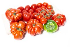 Closeup of various types of tomatoes. A composition of various types of tomatoes, such as the Florentine Costoluto, the cherry and the datterino. Typical in the Royalty Free Stock Photo