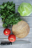 Composition of vegetables on grey wooden desk. Royalty Free Stock Image