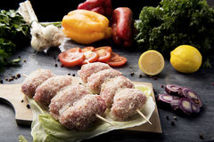 Composition of vegetables and meat rolls Stock Photos