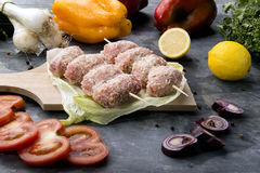 Composition of vegetables and raw meat rolls to bake Royalty Free Stock Photos