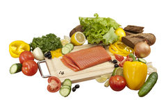Composition of vegetables and salmon. Composition of meny fresh vegetables and salmon Stock Images