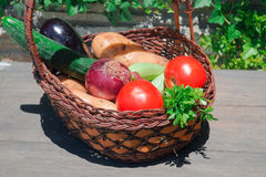 Composition with vegetables  in wicker basket Royalty Free Stock Photos