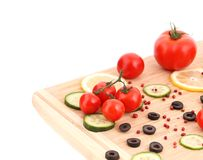 Composition of vegetables on wooden platter. Royalty Free Stock Photo