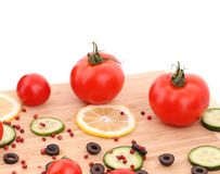 Composition of vegetables on wooden platter. Stock Images