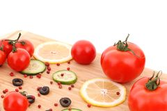 Composition of vegetables on wooden platter. Royalty Free Stock Images