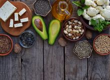 Composition of vegetarian products containing unsaturated fatty acids Omega 3 - nuts, hemp, chia, flax, avocado, soybeans, caulifl. Ower, pumpkin seeds, tofu Royalty Free Stock Images