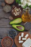 Composition of vegetarian products containing unsaturated fatty acids Omega 3 - nuts, hemp, chia, flax, avocado, soybeans, caulifl. Ower, pumpkin seeds, tofu Stock Image