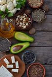 Composition of vegetarian products containing unsaturated fatty acids Omega 3 - nuts, hemp, chia, flax, avocado, soybeans, caulifl. Composition of vegetarian Stock Photo