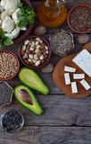 Composition of vegetarian products containing unsaturated fatty acids Omega 3 - nuts, hemp, chia, flax, avocado, soybeans, caulifl. Ower, pumpkin seeds, tofu Royalty Free Stock Photo