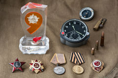 Composition of Victory Day. orders, medals, live ammunition, aviation onboard watch. Stock Photo