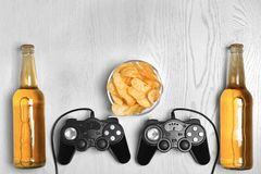 Composition with video game controllers. Beer and snack on light background Royalty Free Stock Photography