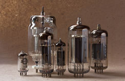 Composition of vintage electronic vacuum tubes on kraft paper background. Royalty Free Stock Images