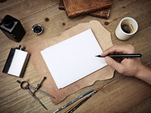 Composition of vintage elements and hand drawing on blank page Royalty Free Stock Photos
