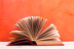 Composition with vintage old hardback books, diary, fanned pages Royalty Free Stock Photography