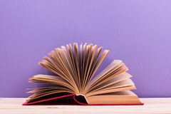 Composition with vintage old hardback books, diary, fanned pages Royalty Free Stock Photos