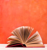 Composition with vintage old hardback books, diary, fanned pages Royalty Free Stock Image