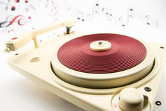 Composition with vintage red record player and musical notes Stock Photo