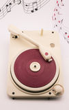 Composition with vintage red record player and musical notes Royalty Free Stock Photos