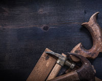 Composition of vintage square ruler rusted claw hammers hand saw Stock Image