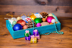 Composition of vintage wooden box with Christmas decoration, tin Royalty Free Stock Image