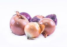 Composition of violet - blue and ocher onions on a white background Royalty Free Stock Photos
