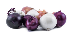 Composition of violet - blue, white and ocher onions on a white background Stock Photos