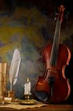 Composition of violin and antique items Royalty Free Stock Images