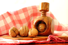 Walnuts and antique nutcracker Royalty Free Stock Photos