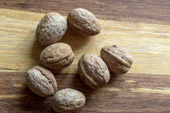 Composition with walnuts over wooden background Stock Photos