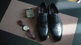 Composition of watches, shoes and toilet water. Men`s accessories. Beautiful accessory stock video