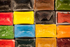 Composition of watercolor paint pieces. Matrix colorful pattern arrangement of watercolor aquarelle single paint boxes, symbolizing fun vivid concept in creative royalty free stock photo