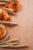 Composition of wheat ears bakery goods on oaken. Wooden board food and drink concept Stock Images