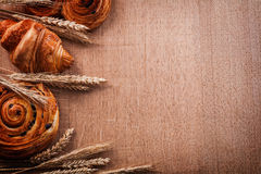 Composition of wheat ears bakery products on oaken. Wooden board food and drink concept Stock Photo