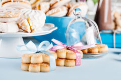 Composition in white and blue with candies, cookies and chocolat Stock Image
