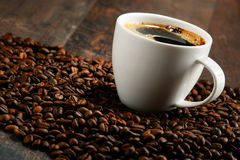 Composition with white cup and coffee beans Stock Photography