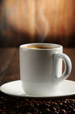 Composition with white cup and coffee beans Royalty Free Stock Photo
