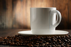 Composition with white cup and coffee beans Royalty Free Stock Photos