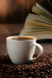 Composition with white cup of coffee and open book Royalty Free Stock Photos